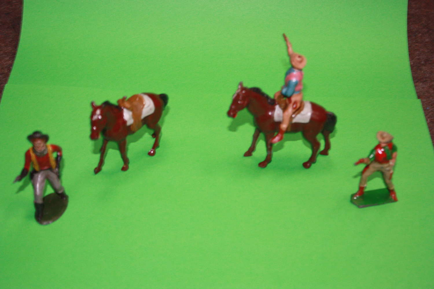 A SMALL GROUP OF JOHN HILL COWBOYS AND HORSES